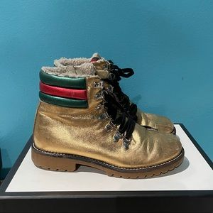 Gold Gucci boots with fur